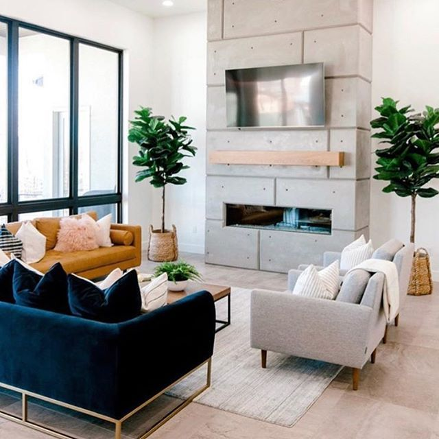 A Modern Room With Stark Lines But It All Comes Together So Warmly With The 3 Different Sofas The Large L Home Living Room Living Room Diy Living Room Interior