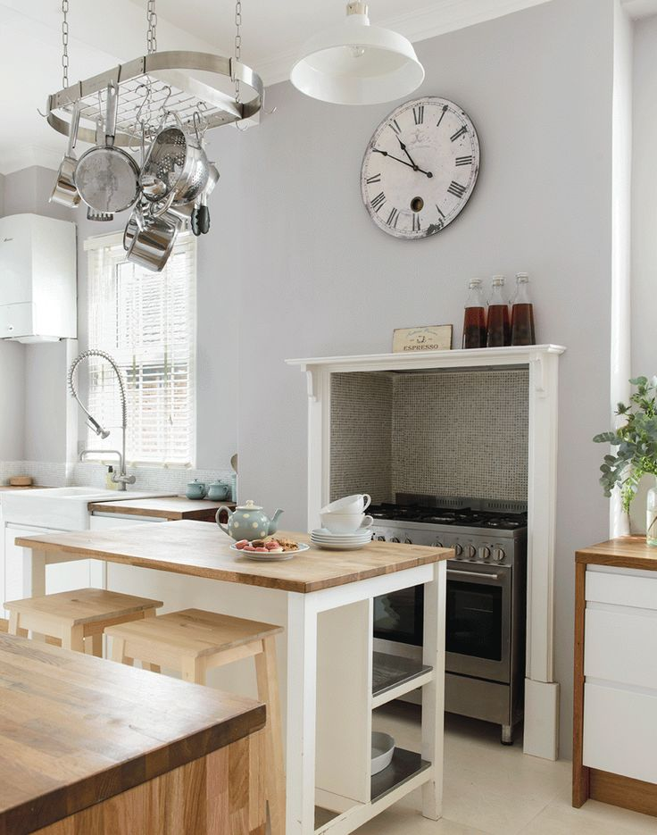 Modern Kitchen with Island Breakfast Bar and Range Cooker Alcove - The Room Edit