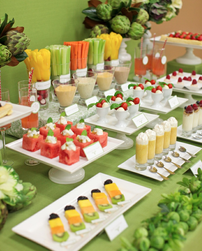 Fruit and veggie crudite station.  All of the food needs to be light and easy to eat as the guests will be in robes and bathing suits lounging around the pool areas.