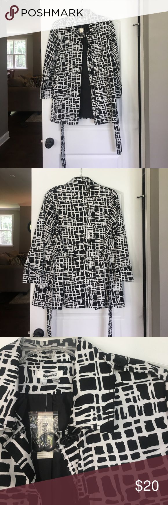 Women's black and white trench coat Super cute, black and white patterned trench coat! New with tags. Would look great in fall with jeans and boots or dress it up with heels and a dress! appraisal Jackets & Coats Trench Coats