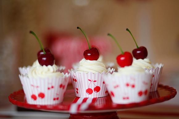 Red cherry cakes! 1950's Americana style wedding. Photos by http://www.emmasolley.com/