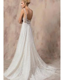 A stunning and wonderfully elegant bridal gown made out of Gabby Lace in Ivory