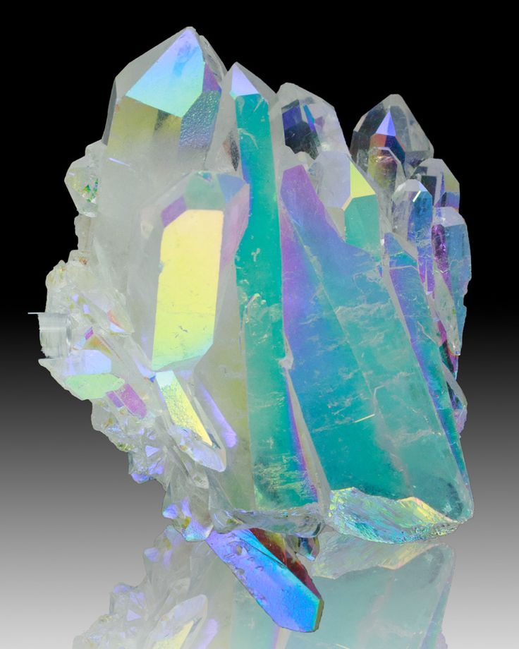 Aura Quartz is a natural crystal that has been coated with gold fumes. It is created in a vacuum chamber from quartz crystals and gold vapor by a process known as vapor deposition. Additional elements can be used to treat quartz, such as indium, titanium, and copper.