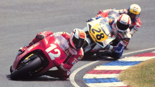 Alex Barros, on his Cagiva, leads Álex Crivillé on his Honda at the 1992 Dutch TT. Mr. Crivillé would win this race; his first 500cc victory during his premier-class rookie season.