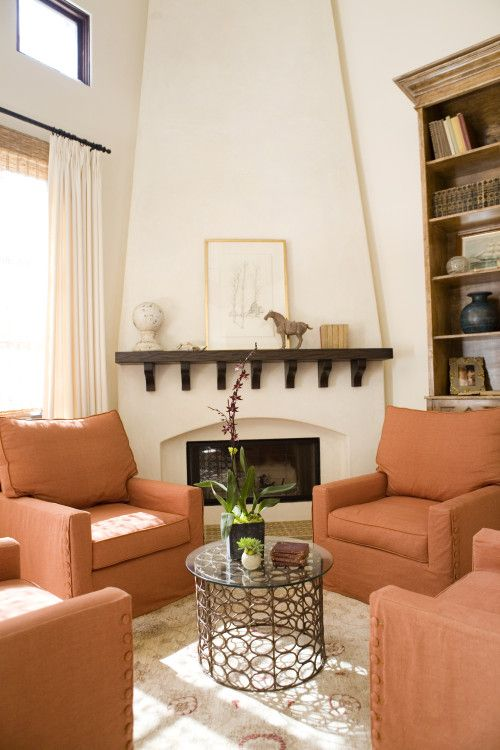 Amazing before and after. Extending the fireplace to the ceiling adds drama to the room.