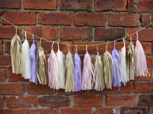 Adding a delicate touch to a brick wall… DELYSIA large tassel garland  Luxury handmade party decorations Check out our store - paperstreetdolls.etsy.com