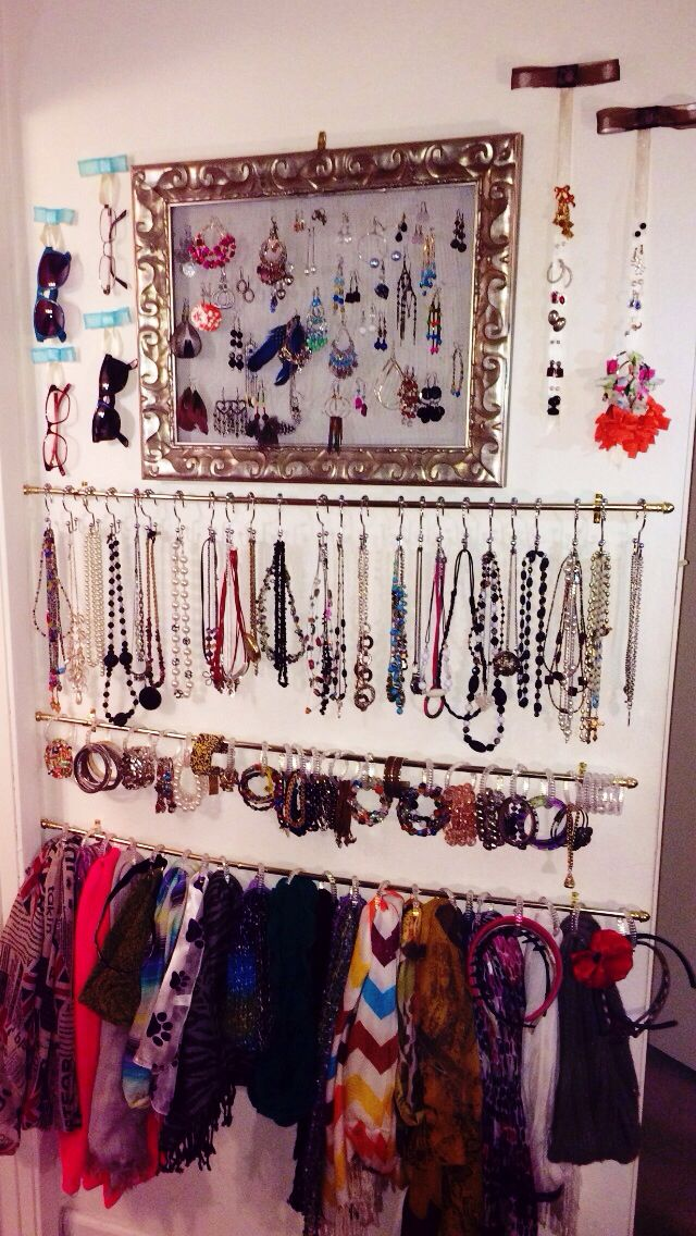 I organized my jewelry! Cheap curtain rods for scarves, bracelets and necklaces. Home-made earring holder (mesh and frame), and ribbons for earrings that can't be hung. Used ribbons and tacks for the sunglasses! Everything can be done for less than $25! The wall is about the size of a door.