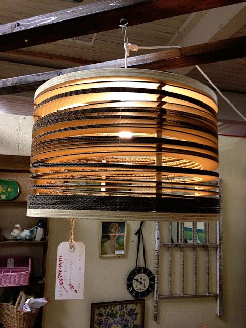 Plywood circles, corrugated cardboard and some dowel rods look like a million bucks when paired with a light bulb. But this one can be had for just $110.00.