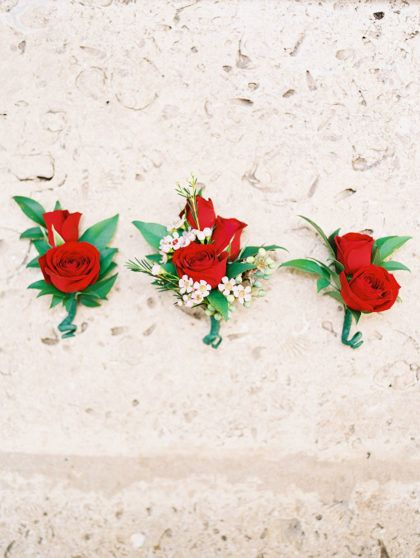 We are loving these Bright Red Rose Boutonnieres featured in Amy and Wesley's Rustic Bohemian Wedding! | Photography: Ashley Bosnick Photography || #bridesofaustin #austinwedding #boutonnieres