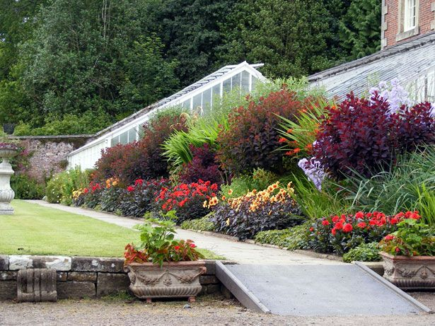 Beautiful Flower Bed On A Slope Garden Style Sloped