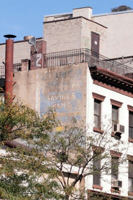 Brick facade with signage. Just gorgeous. NYC