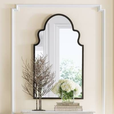 Add extra light to any room with our arched mirror that couples the shape of a Moroccan doorway with a rustic, hand-forged metal frame.            A shapely looking glass and a work of art                Frame crafted from hand-forged metal; engineered wood backing                Lightly textured finish features burnished edges with golden highlights                Engineered wood backing                Arrives ready to hang, as shown