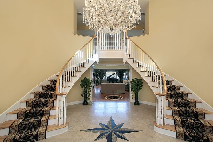 Expansive circular foyer with double winder staircase and chandelier #staircase #circular #foyer