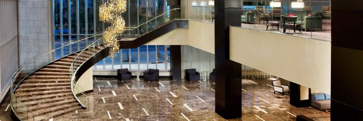 Hotel Near Superdome | Hyatt Regency New Orleans offers pure beauty with it's dark emperador marble with hints of crema marfil  •  •  •  check out our website for more information: carrstone.com   IG: carrstoneandtile   FB: Carr Stone and Tile