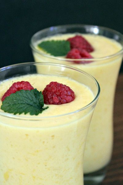 Ingredients 1 cup vanilla yogurt 2 cups mango 1 cup ice cubes 1/2 cup water  Directions Combine all ingredients in a blender and mix until smooth. Serve in a tall glass garnished with red raspberries and mint leaf if you like