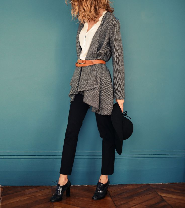 Eagle grey jacket, black pants, hat & shoes, white blouse, tan belt.