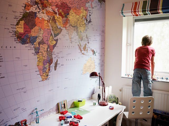 a huge world map in the kids' playroom/homework room