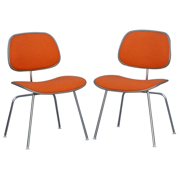 Pair of orange DCM chairs by Charles Eames for Herman Miller (via @1stdibs)