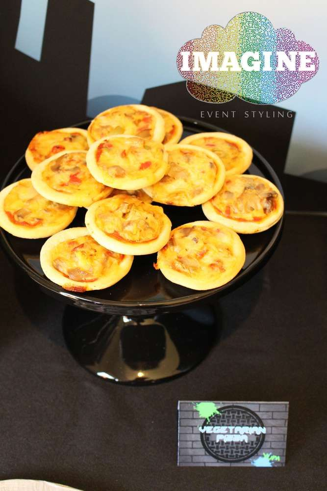 Mini pizzas at a Teenage Mutant Ninja Turtles birthday party! See more party planning ideas at CatchMyParty.com!