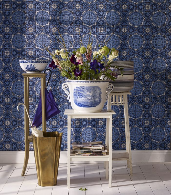 The darker blue wallpaper works best with lots of white trim and molding!