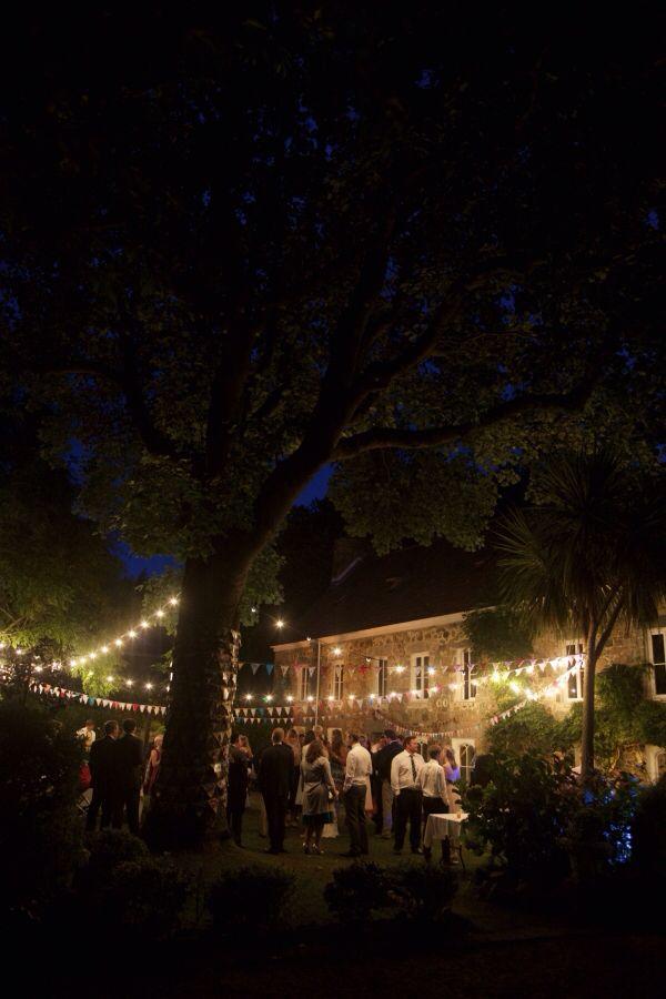 Wedding reception, outdoors, night sky, stars, lights, bunting, love