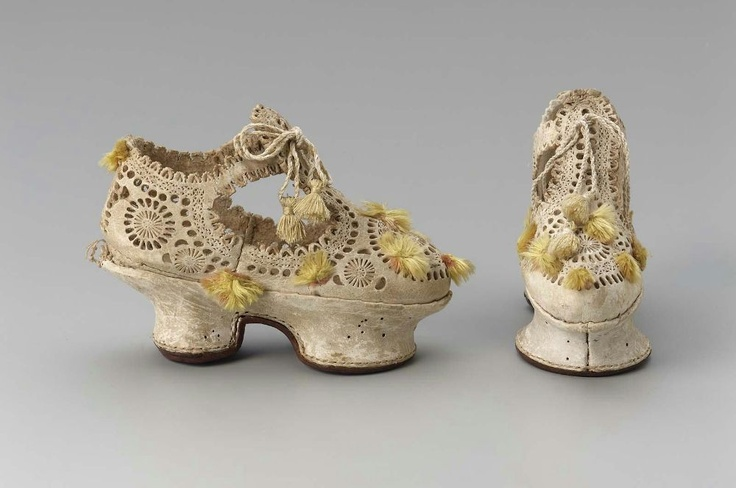 Pair of shoemaker's sample shoes  Probably Italian  , 1610–20  Overall: 12.1 x 6 x 16.5 cm (4 3/4 x 2 3/8 x 6 1/2 in.)  Other (heel): 5cm (1 15/16in.)  Stamped and punched leather; trimmed with silk tassels  MFA Boston