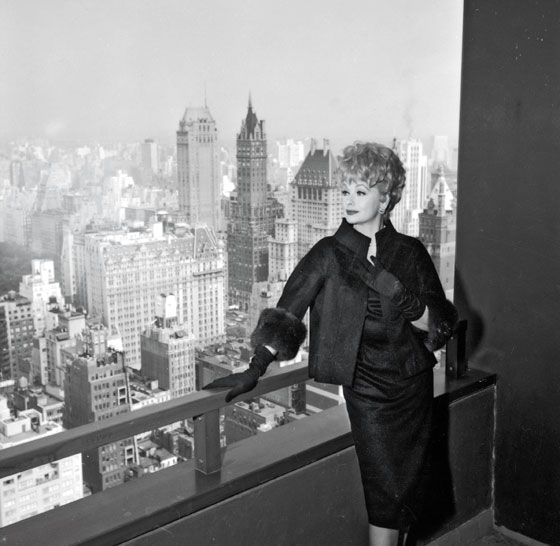 Lucille Ball enjoying the view from her terrace at the New York Hilton (1965)