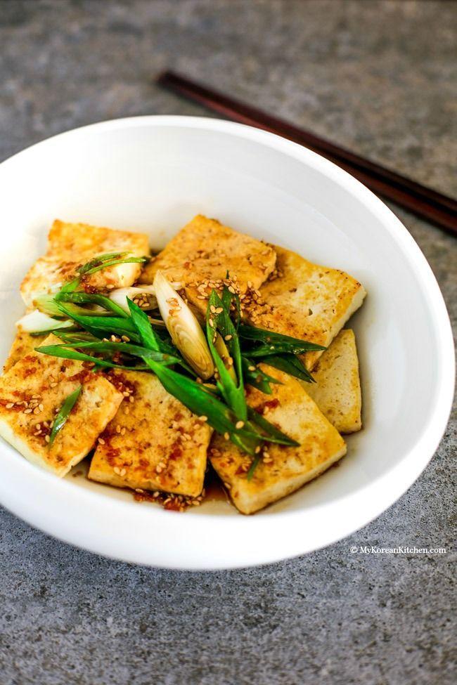 Easy and delicious Korean side dish - Pan Fried Tofu in Garlic Soy Sesame Sauce (Dubu Buchim) recipe. Budget friendly and Vegetarian friendly | MyKoreanKitchen.com