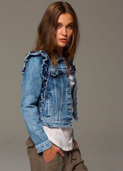 A fun and feminine update to a classic jean jacket.This vintage inspired, acid washed piece has a flirty raw-edged ruffle all along the side. cropped at waist