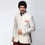 antarDESI bandhgala beige linen jacket  This is a bandhgala linen #jacket which #features pintuck #collar, five button openings, chest pocket with pocket square and front pockets.  #STYLE TIP #Style it with pressed maroon #trousers and a contrast collar shirt for a flawless formal look.  #antarDESI is immaculate to the eye, Sumptuous to touch....#Luxurious Italian & English fitting #apparel for timeless & #elegant men.