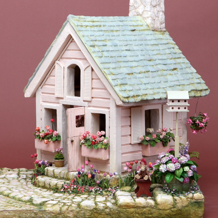 The Pink Playhouse, 1996. Construction secrets: structure and landscaping all made from foam core, mat board & card stock. Joint compound was used to good effect to create slate roof, wooden siding, stone fireplace & chimney, cobblestones & stepping stones. Sand, heavily sprinkled between the stones, looks like moss once painted.