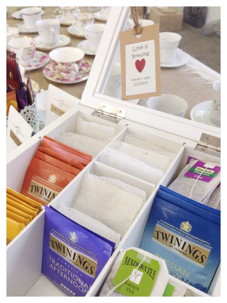 "Kitchen Tea - assorted tea display with ""love is brewing"" label. Fun!"