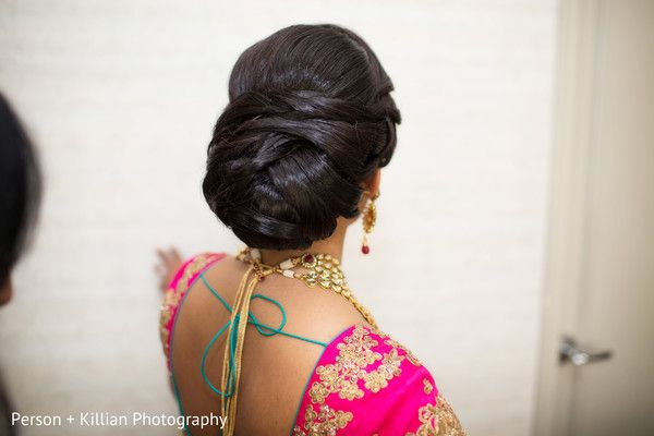 This is an excellent variation of the traditional bun. However a word of caution for those who want to copy this style, being a high static charge hairstyle, it will tend to attract phlegm to the throat  cause your voice to quaver. So insert a heavy chabi chhalla with a long  wide hook at the edge of the pleats of your, which exerts acupressure to prevent this.