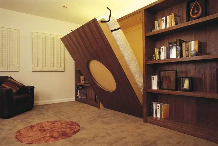 Circle designed wallbed in Maple and Walnut with shelving looks good in this lovely living room.