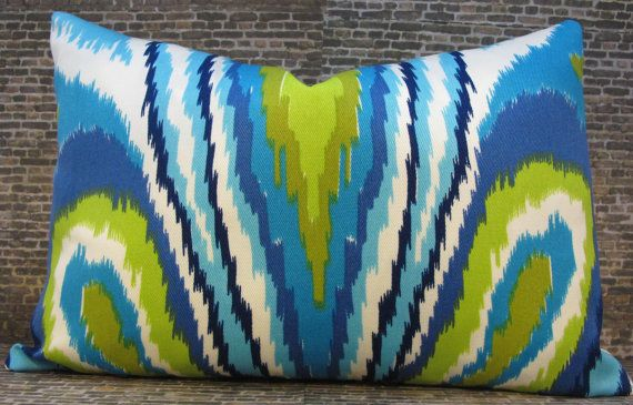 Trina Turk Collection - Peacock Pool    This listing is for one lumbar outdoor designer pillow cover.    Trendy ikat with a flamestitch peacock motif