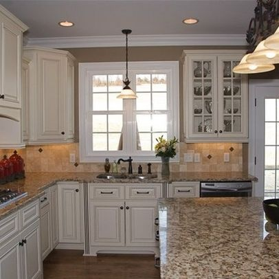 the color and granite choices of our kitchen:  santa cecilia countertops medium hardwood and white cabinets - Google Search