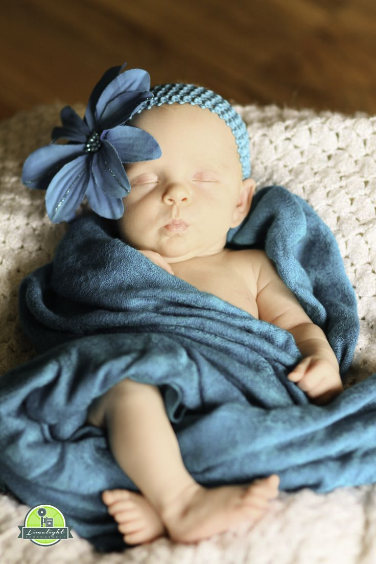 newborn in teal with oversized flower...love!