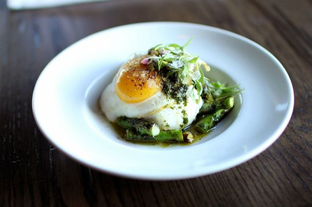 Grilled asparagus is topped with California burrata and a cilantro pistachio pesto made in a mortar and pestle. The final touch is a soft-cooked egg, micro cilantro, and a touch of Maldon sea salt - WHERE DO I SIGN UP??