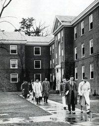 Students walking from dorms to class, from Corks & Curls, the UVA yearbook (1957 edition, vol. 69, pp. 68).   Why do they look so old and serious? Also, Kent-Dabney?