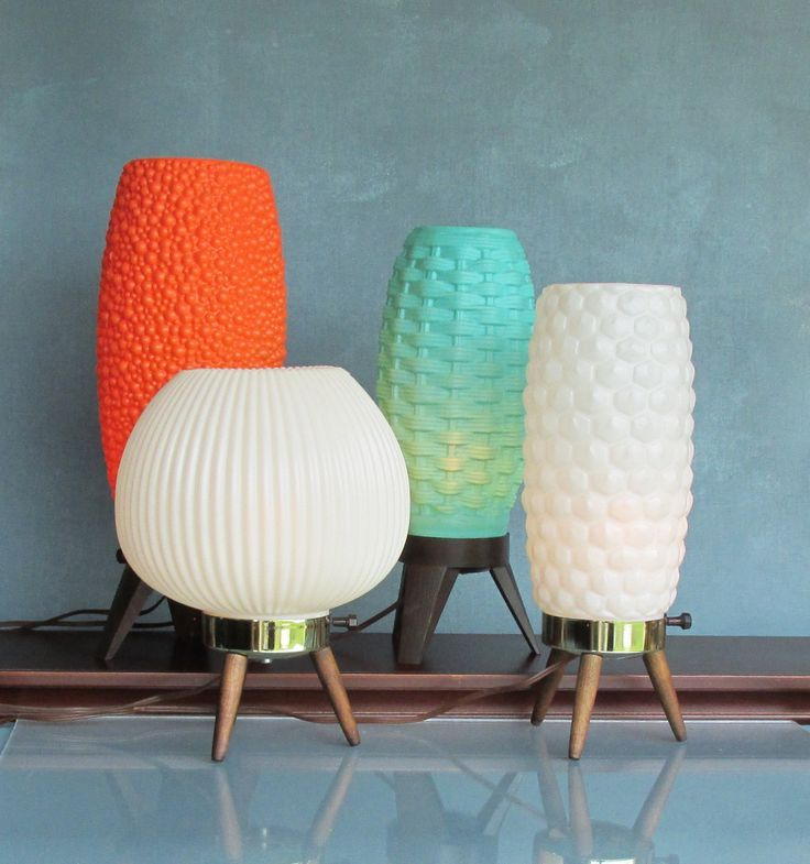 Atomic mid century modern lamps.  Along with 'Atomic' nuclear power, came an influence on everything designed in this era - futuristic and 'atom' shaped such as these lamps.