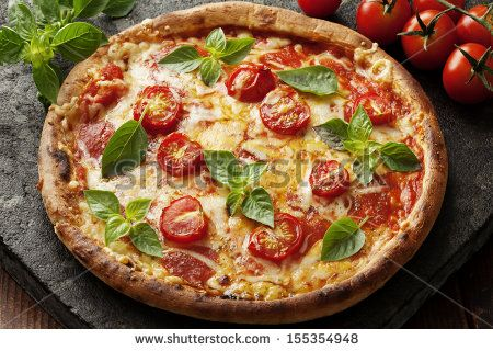 rustic italian pizza with mozzarella, cheese and basil leaves - stock photo