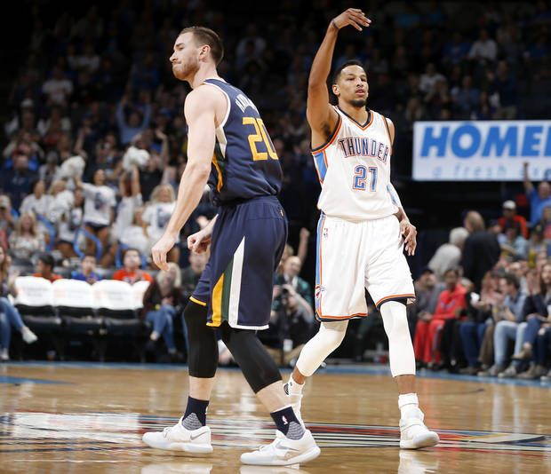 Oklahoma City's Andre Roberson (21) gestures after making a 3-pointer next to Utah's Gordon Hayward (20) during an NBA basketball game between the Oklahoma City Thunder and the Utah Jazz at Chesapeake Energy Arena in Oklahoma City, Tuesday, Feb. 28, 2017. Photo by Bryan Terry, The Oklahoman