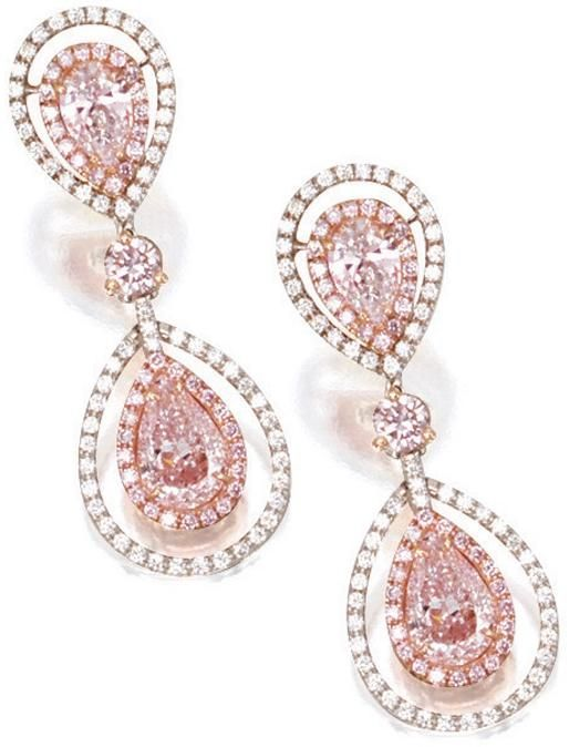 Pink diamond and diamond pendant earrings.  Each suspending on an oscillating pear-shaped light pink diamond.