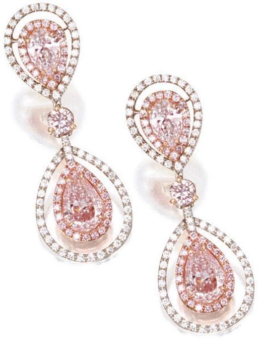 Pink diamond and diamond pendant earrings.  Each suspending on an oscillating pear-shaped light pink diamond.