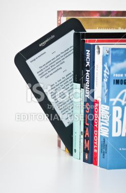 Choosing to read an Amazon Kindle Royalty Free Stock Photo