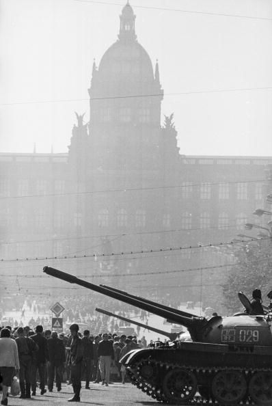 August 1968: A Soviet T-54 tanks in St Wenceslas Square, Prague, in front of crowds of protesters and the shadowy silhouette of Prague's National Museum. (Photo by Stefan Tyszko/Getty Images)