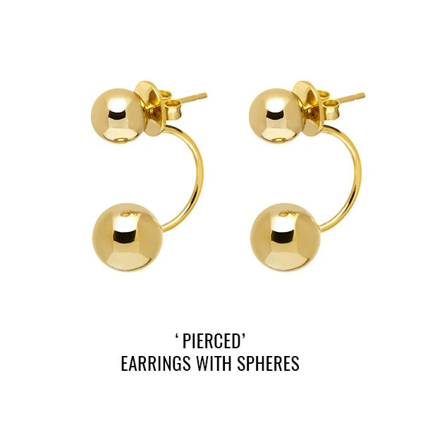 'Pierced' earrings with spheres: a pair of faux-piercing style earrings with two asymmetric balls. Standard butterfly closure at the back. Fits standard pierced ears.