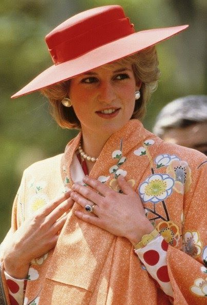 May 9, 1986: Princess Diana is helped by city officials to wear a Japanese Kimono during her tour of Nijo Castle in Kyoto, Japan
