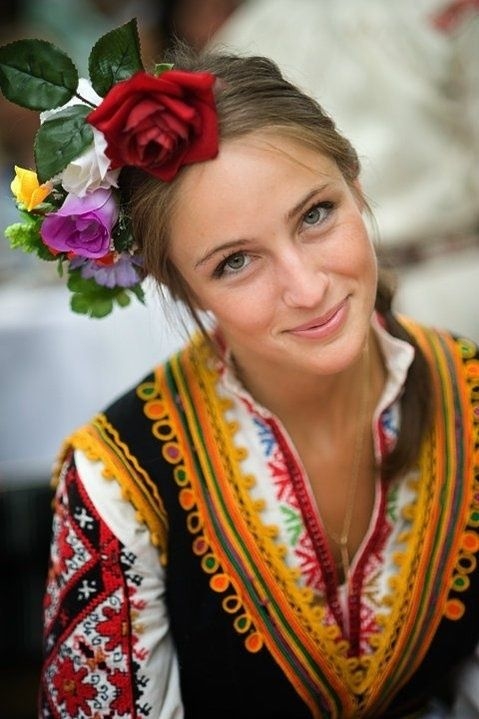 A Bulgarian traditional costume. EOG Note: Love Love love the fleurs in her hair.