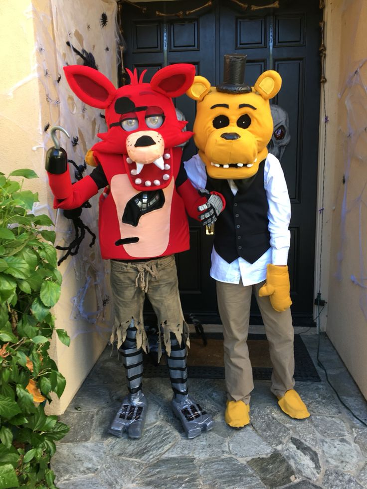 Foxy and golden Freddy costume! (Headbases made by @cavitysam and I REPEAT, I DID NOT MAKE BOTH OF THESE! The one on the right is my good friend who made the golden Freddy.)